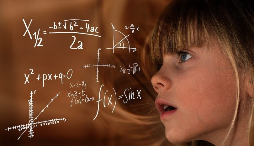 Young girl solves mathematics problem