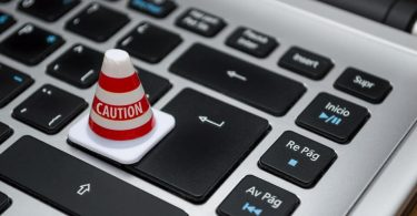 laptop-keyboard-caution-cone-over-enter