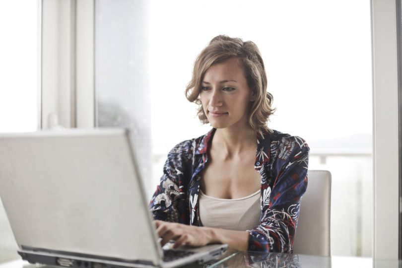 A mom working at a computer
