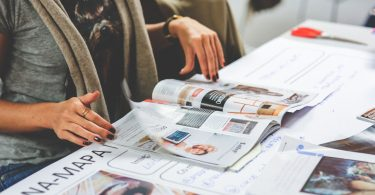 Person reading an article in a newspaper