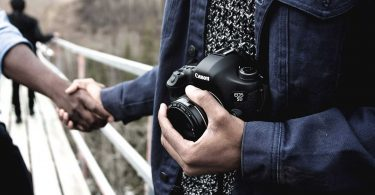 Business owner outsourcing creative work to a freelance photographer