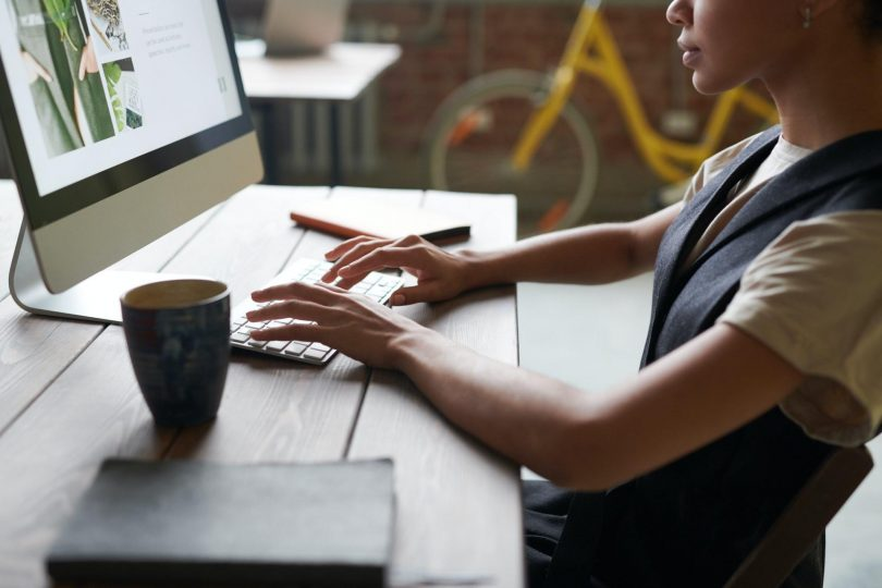 Person sat at a computer researching good B2B business ideas.