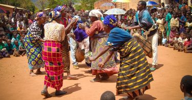 Malawians dancing because they've received support from MicroEnterprise Africa